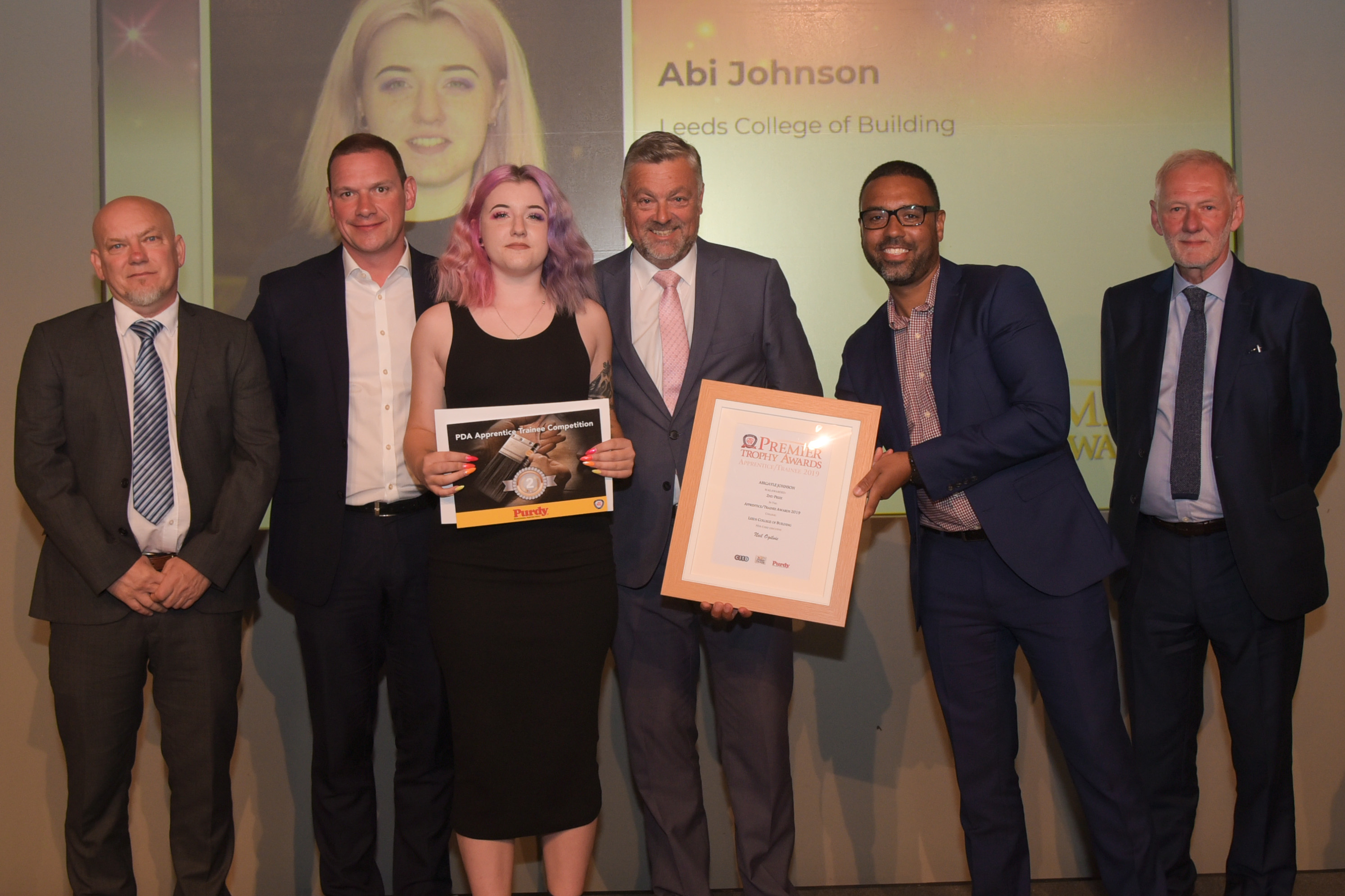Apprentice Abi Johnson Winner (L to R): Mark Howroyd (Leeds College of Building), Alistair McAuley (Akzonobel [Dulux Trade]), Abi Johnson, Rob Davis (Purdy), Nathan Wilkins (CITB), Andrew Davis (Association of Painting Craft Teachers)